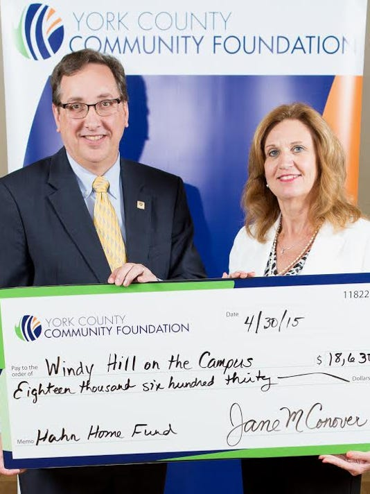 Michael Hady, York County Community Foundation board director, left, presented the grant to Tammy Miller, executive director, Windy Hill on the Campus.