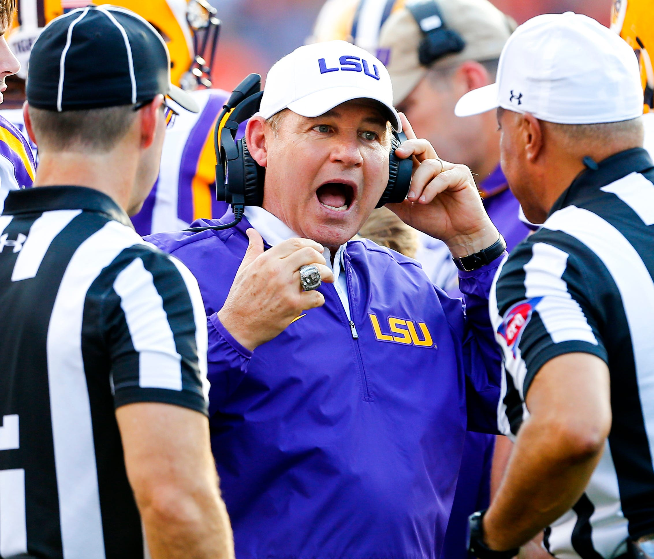 FILE - This Sept. 24, 2016 file photo shows LSU head coach Les Miles reacting to a call during the first half of an NCAA college football game against Auburn in Auburn, Ala. Two people familiar with the decision say LSU has fired Miles and offensive