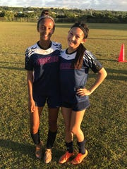 St. Paul Christian School Warriors, Lily Franklin, left, and Chloe Miranda, right, each scored a goal to give the Warriors a 2-1 win over the John F. Kennedy Islanders in a IIAAG Girls Soccer playoff game on Wednesday, May 10.