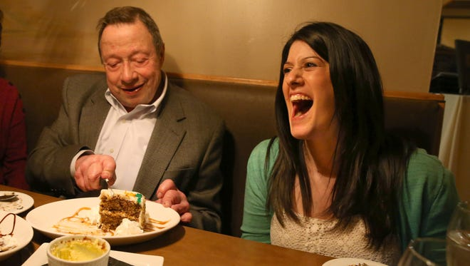 Adena Miller bursts out laughing as Dick Horwitz dives into a second pice of carrot cake brought to the table at Joey's Pasta House, during their Penfield food crawl Tuesday, April 4, 2017.