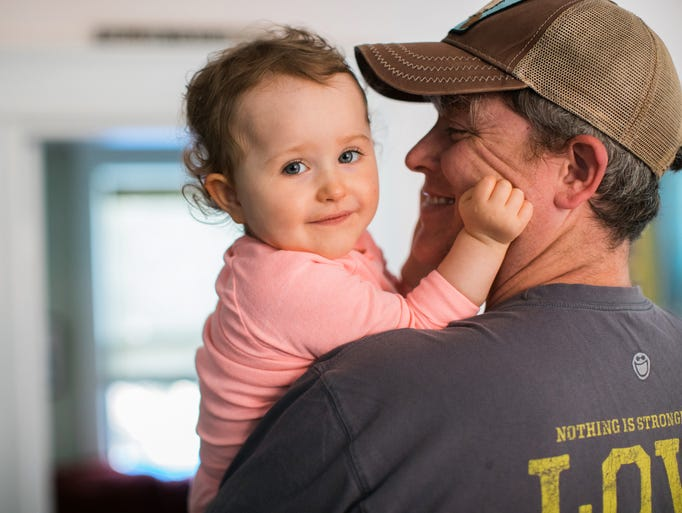 Cordelia Burrows, 2, with her father Daniel Burrows