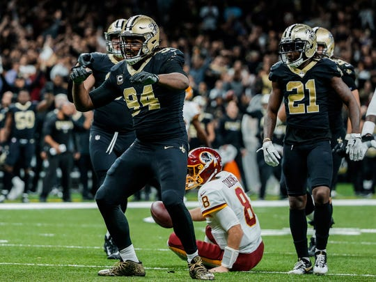 New Orleans Saints defensive end Cameron Jordan celebrates after a sack against the Washington Redskins during overtime of a game at the Mercedes-Benz Superdome.