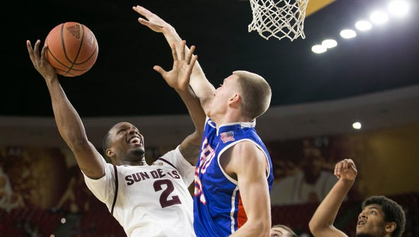 ASU forward Willie Atwood puts up a shot as Houston