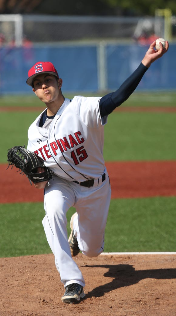 Archbishop Stepinac pitcher Austin Mercado delivers