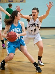 Essex's Erin Murphy (right) pressures South Burlington's Kayla Gilding during a game last season in Essex