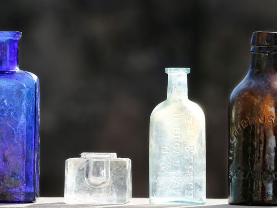 A variety of bottles and an inkwell that were recovered