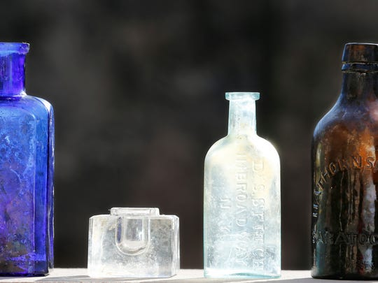 A variety of bottles and an inkwell that were recovered from an outhouse next to the Moses Fowler House Thursday, February 2, 2017 in Lafayette. The old outhouse, which had long since been covered by soil, was discovered late Tuesday during construction work at the Moses Fowler House. Along with the bottles and other items, including china, toys, teapot, toothbrushes, combs  and even dentures were discovered. Cobly Bartlett, who is executive director of the 1852 Foundation, said most of the items date to the 1850s to 1870s.