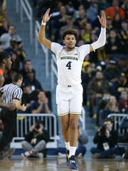 Isaiah Livers reacts during the first half of Michigan's
