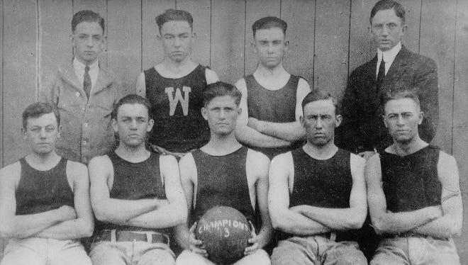 Led by Homer Stonebraker (holding the ball), tiny Wingate won state titles in 1913, 1914.