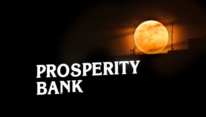 A supermoon is rising over the Prosperity Bank sign in downtown Abilene Monday, Nov. 14, 2016. This is the closest the full moon has been to Earth since 1948, according to NASA. We won't see another supermoon like this until 2034.