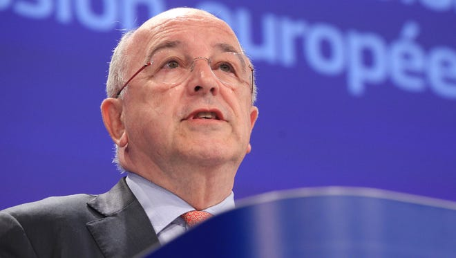 European Commissioner for Competition Joaquin Almunia gives a news conference on tax probe on Apple, Starbucks and Fiat, at the EU headquarters in Brussels on June 11, 2014.