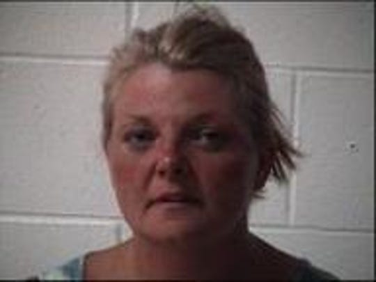 Kelly Ann Dooley, 40, was taken into custody in Indiana after leading officers on a chase.