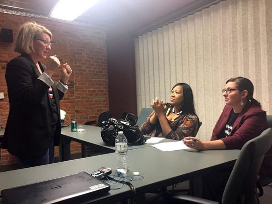 From left, Dawn Crandall, one of the trainers and board member of Vote Run Lead, talking with Tamara Liberty Smith, a candidate for Detroit City Council and Christine Mullan, a candidate for the Grand Rapids City Council during the training session in Ypsilanti on May 6, 2017.