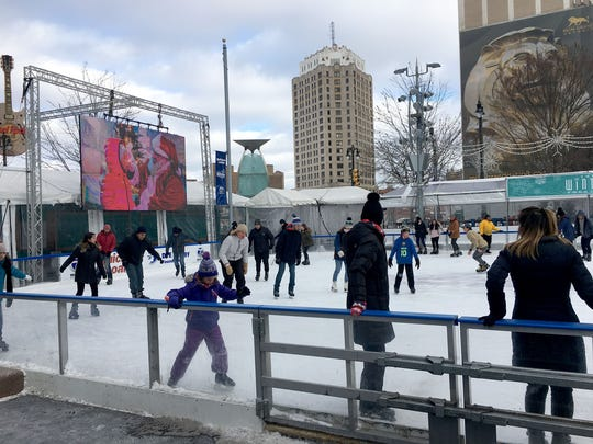 The ice skaters at Campus Martius Park in downtown