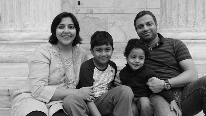 Aditi Patil with her husband Amrit and children Advay and Arjun.