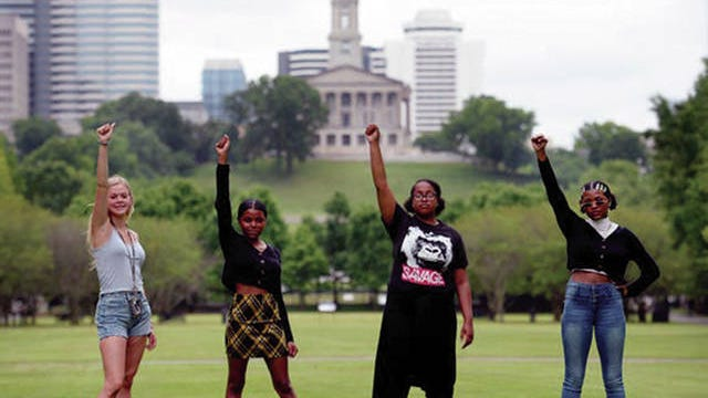 Emma Rose Smith, 15, left, Kennedy Green, 14, Mikayla Smith, 16, and Nya Collins, 16, met on Twitter and organized a June rally to honor Black victims of police violence. They stand together in Nashville last week. The girls, along with Jade Fuller and Zee Thomas, organized the rally in June which tens of thousands of people attended, marching through downtown Nashville for social justice.