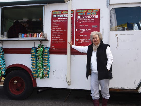 Carole Crusco, owner of Carole's Hot Dogs, stands outside
