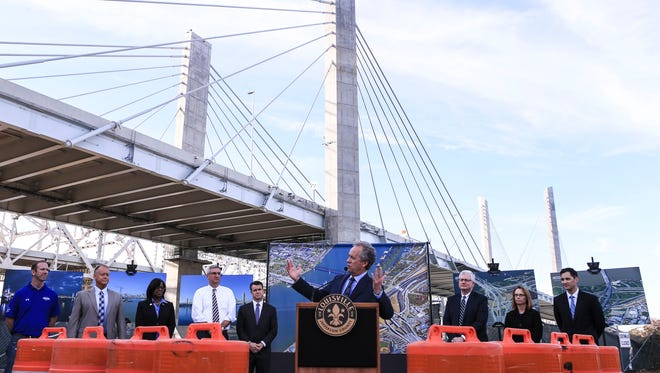 """""""This is a transformative era of construction and investment in downtown Louisville,"""" said Louisville Mayor Greg Fischer. """"For the last 3 ½ years, the most visible symbol of this growth has been the new Lincoln Bridge."""" Fischer was among other public officials such as the Indiana Governor and Kentucky Lt. Gov who talked about the importance of the bridges project during the official celebration of the completion of the downtown crossing portion of the Ohio River Bridges Project Friday afternoon."""