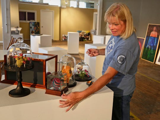 Eileen Urness of Cedar Grove arranges her display of polymer over egg creations Wednesday September 23, 2015 that will be part of an art show at Sheboygan Visual Artists this Friday.