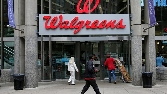 FILE - This June 4, 2014, file photo, shows a Walgreens retail store in Boston. Shares of AmerisourceBergen are soaring before the opening bell, Tuesday, Feb. 13, 2018,  on reports that Walgreens is pursuing a complete takeover of the huge drug distributor. The Wall Street Journal is reporting that Walgreens CEO Stefano Pessina reached out to AmerisourceBergen Corp. with the potential deal. Walgreens already owns about 26 percent of the company. (AP Photo/Charles Krupa, File) ORG XMIT: NY109