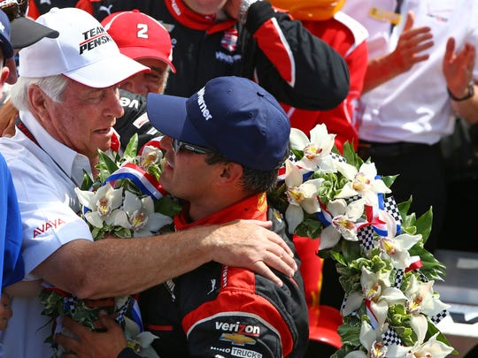 May 24, 2015: Team owner Roger Penske (left) hugs IndyCar