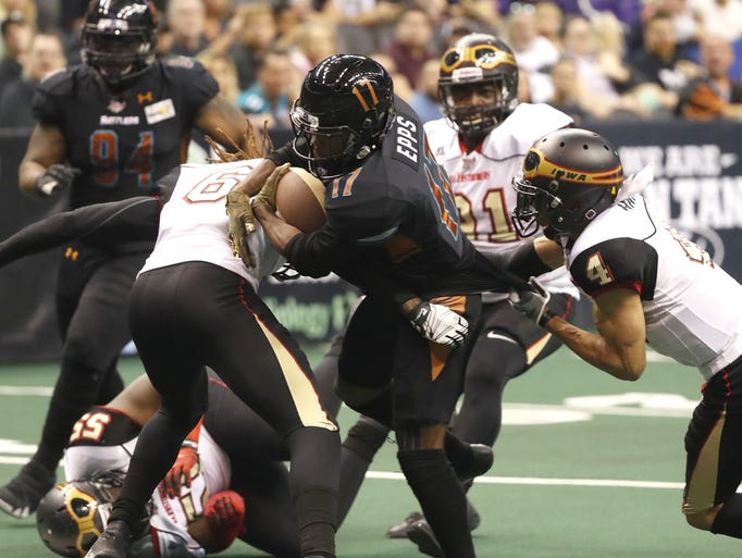 The Barnstormers' Jeremy Gloston (6) tackles the Rattlers'