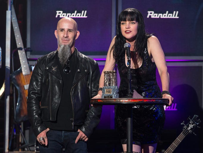 Guitarist Scott Ian of Anthrax, left, and actress Pauley Perrette on stage at the 6th Annual Revolver Golden Gods Award Show at Club Nokia on April 23, 2014 in Los Angeles, California. (Photo by Paul A. Hebert/Invision/AP)