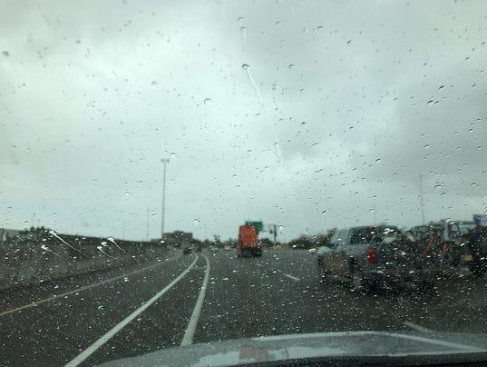 Rain soaks roads