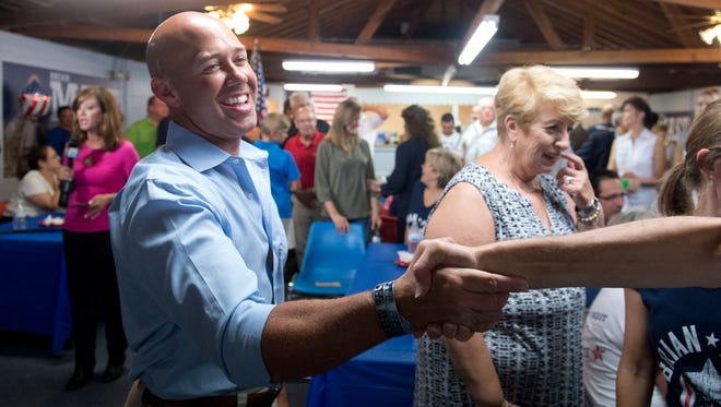 Brian Mast greets a supporter Aug. 30 at his election party at the Palm City Civic Center Mast won the Florida Congressional District 18 Republican primary race, defeating Carl Domino, Mark Freeman, Rick Kozell, Noelle Nikpour and Rebecca Negron.