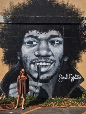 One of Painter's iconic pieces is an inquisitive Jimi Hendrix with wandering eyes looking at you from a wall on what used to be the Sidebar Theatre.