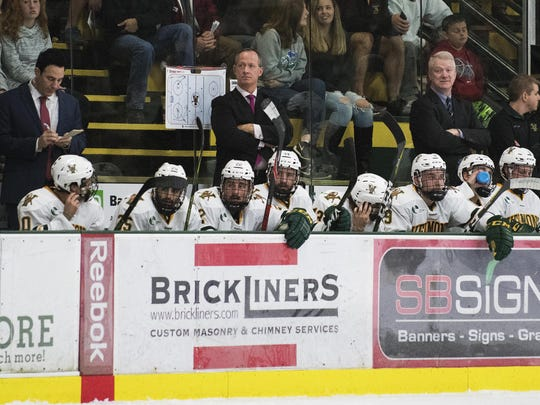 Vermont head coach Kevin Sneddon looks on during the men's hockey game between the Clarkson Golden Knights and the Vermont Catamounts at Gutterson Fieldhouse last season.