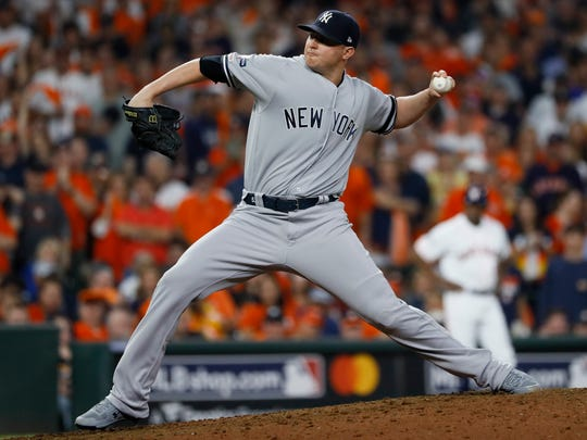 New York Yankees relief pitcher Zack Britton throws against the Houston Astros during the eighth inning in Game 2 of baseball's American League Championship Series Sunday, Oct. 13, 2019, in Houston. (AP Photo/Matt Slocum)