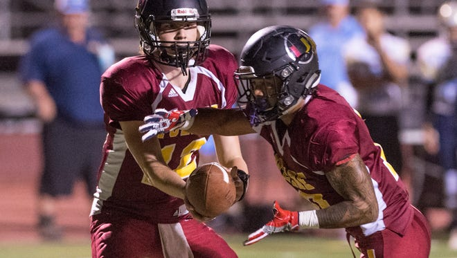 Tulare Union's Nathan Lamb hands off to Tulare Union's Kazmeir Allen against Monache in an East Yosemite League football game on Thursday, October 5, 2017.