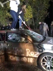 One of the pictures of the car, which is painted with a racist comment.
