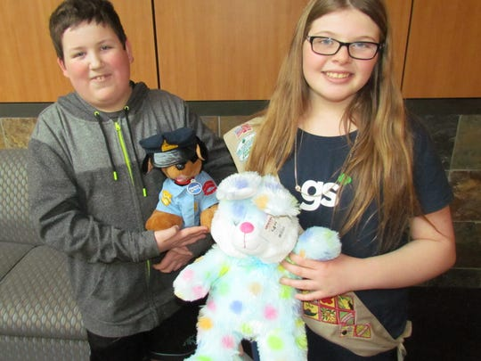 """Ashlee Ellis, an 8th-grade student at Whiteaker Middle School in Keizer, and her classmate and friend Michael Austin display a couple of the more than 100 """"comfort items"""" they delivered to Santiam Hospital as part of Ashlee's Girl Scouts Silver Award project. They also delivered similar items gathered to Salem Hospital's emergency room, pediatrics, Silverton Hospital and has plans to make a delivery to Dallas Hospital."""