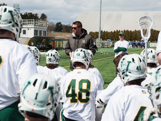Vermont head coach Chris Feifs talks to the team at half time during the men's lacrosse game between there UMass Lowell Riverhawks and the Vermont Catamounts at Virtue Field on Saturday afternoon April 7, 2018 in Burlington. (BRIAN JENKINS/for the FREE PRESS)