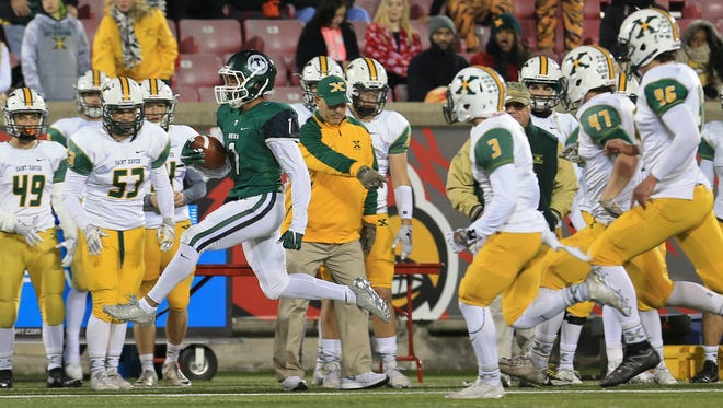 Trinity's Rondale Moore looked for running room as the Rocks beat the Tigers 24-14 Friday night at the 6A semi-state game.