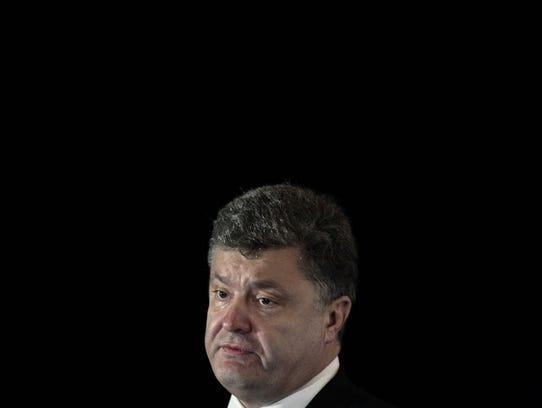 Ukrainian President Petro Poroshenko delivers an address
