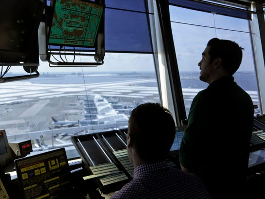 Air traffic controllers work March 16, 2017, in the