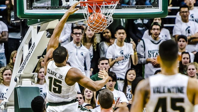 Marvin Clark, here dunking on a fastbreak during the Spartans' game with Binghamton Saturday, is battling for playing time at power forward with Javon Bess and Deyonta Davis.