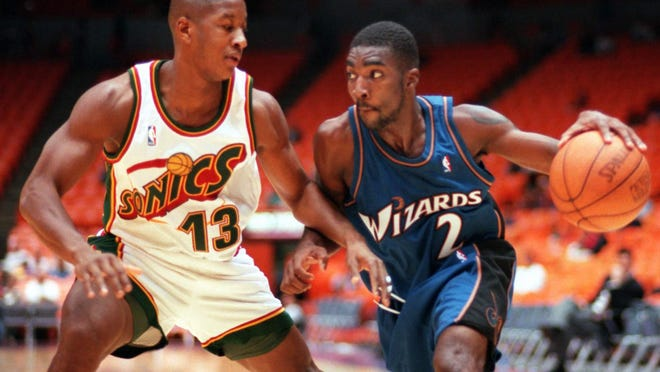 God Shammgod, right, the former Providence College player who went on to play in the NBA, including this game with the Washington Wizards in 1997, is now an assistant coach with the Dallas Mavericks. It was announced last week that he would finally be getting a shoe named after him.