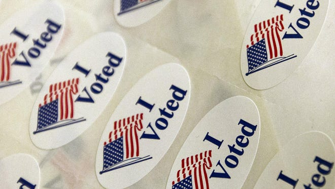Voting stickers at Travis County polling place, 2014 file photo.