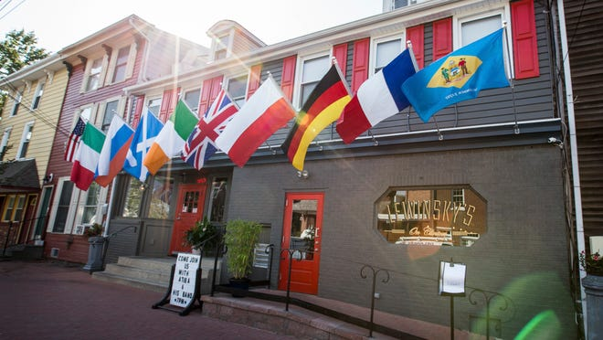 Flags fly in front of Lewinsky's on Clinton in Delaware City.