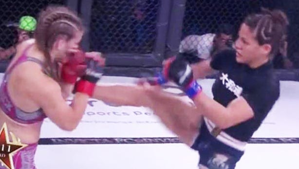 Guam's Brogan Walker Sanchez kicks Miranda Maverick at the Invicta FC 30 in Kansas City, Mo. on July 21. The pro MMA fighter from Guam won by unanimous decision over Maverick.