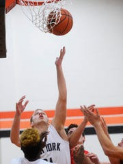 West York's Austin Frey jumps above the crowd under the net during the opening boys' basketball game of the York Suburban Tip Off Tournament at York Suburban High School Friday, December 4, 2015.  West York beat Red Land 57-40.