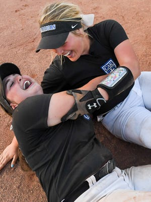 Christian Academy of Knoxville's Emma Webb (10) and Lexi Harmon (12) celebrate in the infield at the end of their 2017 Class AA State Girls' Softball Championship game, Friday, May 26. CAK defeated McNairy Central in two games.