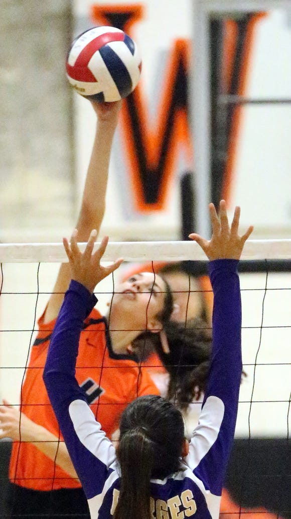 El Paso High's Emily Perez, 4, reaches up to get the