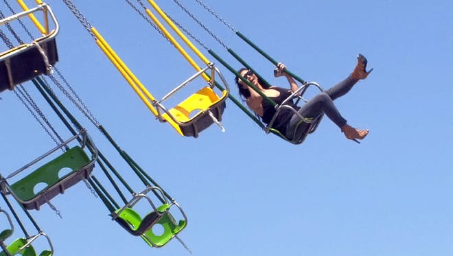 In this file photo, Kim Kardashian rides on the Casino Pier swings in Seaside Heights, July 8, 2014.