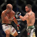 "Frankie Edgar (right) strikes B.J. Penn during their UFC 112 lightweight championship bout in on April 10, 2010. The two decorated MMA fighters will coach against each other on the latest season of ""The Ultimate Fighter."""