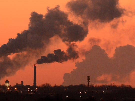 The dome of Jesse Hall, left, is framed between the twin stacks of the power plant at the University of Missouri,  as steam from the Callaway nuclear power plant, right, drifts into the near zero-degree air before sunrise, Friday, Feb. 27, 2015, in Columbia, Mo. (AP Photo/Missourian, Brian Kratzer)